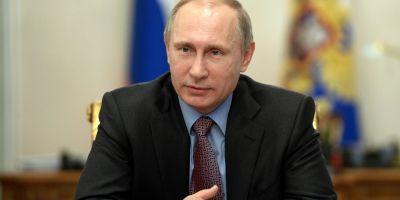Putin cere Kievului sa nu ii impiedice pe soldatii ucraineni, incercuiti de separatisti, sa depuna armele