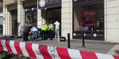 FOTO Atac armat intr-un magazin de lux din centrul Bucurestiului. O vanzatoare a murit dupa ce a fost injunghiata in gat de mai multe ori